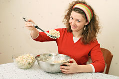 Young woman eating salad. With greediness Stock Image