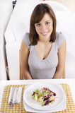 Young woman eating salad Royalty Free Stock Photos