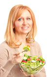 A young woman eating salad Royalty Free Stock Image