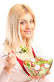 Young woman eating salad Stock Photos