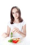Young woman eating salad Royalty Free Stock Image