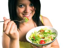 Young woman eating salad royalty free stock images