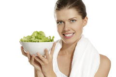 Young woman eating salad after fitness Stock Photography