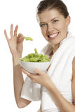 Young woman eating salad after fitness Royalty Free Stock Photos
