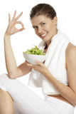 Young woman eating salad after fitness Stock Image