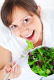 Young woman eating salad Stock Photo