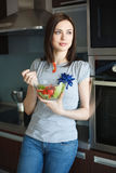 Young woman is eating salad Royalty Free Stock Images