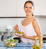 Young woman eating salad with vegetables Royalty Free Stock Photo