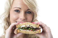 Young Woman Eating a Sandwich royalty free stock photography