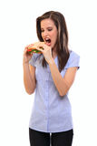 Young woman eating sandwich isolated on white Stock Photography