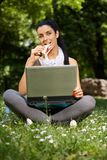 Young woman eating sandwitch in park Royalty Free Stock Image