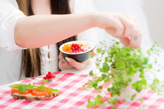 Young woman is eating snack Stock Image