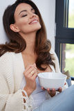 Young woman eating soup. royalty free stock photo