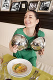 Young woman eating spaghetti Royalty Free Stock Images