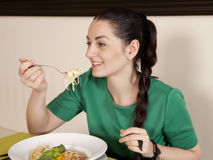 Young woman eating spaghetti Royalty Free Stock Image