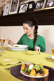 Young woman eating spaghetti Stock Photos