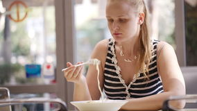 Young woman eating spaghetti. Stock Photography