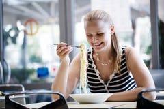 Young woman eating spaghetti Stock Photos