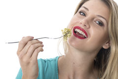 Young Woman Eating Spinach and Pine Nut Pasta Stock Photo
