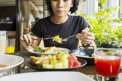 Young woman eating steak in the restaurant Royalty Free Stock Photography