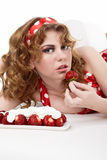 Young Woman eating strawberries Stock Photography