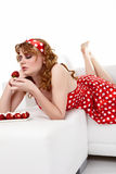 Young Woman eating strawberries Royalty Free Stock Photography
