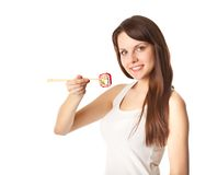 Young woman is eating sushi Stock Images
