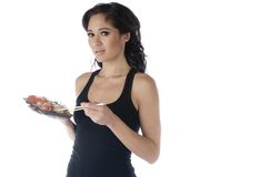 Young woman eating sushi Stock Photography