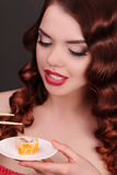 Young woman eating sushi with a chopsticks Royalty Free Stock Images