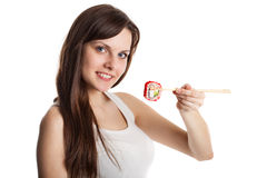 Young woman is eating sushi Stock Photos