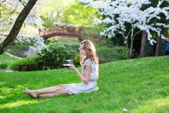Young woman eating sushi in Japanese park Royalty Free Stock Image