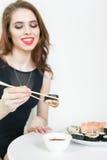Young woman eating sushi at Japanese restaurant Royalty Free Stock Image