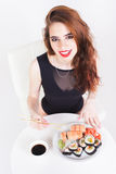 Young woman eating sushi at Japanese restaurant Stock Photography