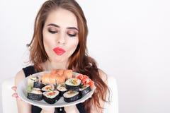 Young woman eating sushi at Japanese restaurant Royalty Free Stock Photos