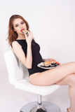 Young woman eating sushi at Japanese restaurant Royalty Free Stock Images