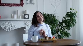 Young woman eating sushi rolls in japan restaurant stock video