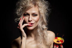 Young woman eating the tar Royalty Free Stock Photography