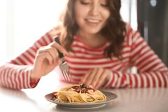 Free Young Woman Eating Tasty Pasta At Table Royalty Free Stock Photography - 150017067
