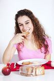Young woman eating toast Stock Photography