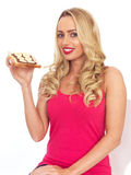 Young Woman Eating Toast with Chocolate Spread and Banana Stock Photography