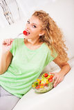 Young woman eating tomato Royalty Free Stock Photos