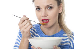 Young Woman Eating Tomato Soup Royalty Free Stock Images