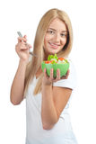Young woman eating vegetable salad Royalty Free Stock Photography