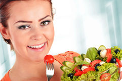 Young woman eating vegetable salad Stock Photos
