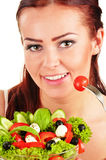 Young woman eating vegetable salad Royalty Free Stock Photo