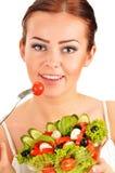 Young woman eating vegetable salad Stock Photo