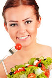 Young woman eating vegetable salad Royalty Free Stock Photos