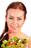 Young woman eating vegetable salad Stock Image