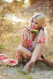 Young woman eating watermelon outdoors. Royalty Free Stock Photo
