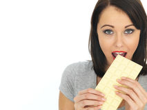 Young Woman Eating a White Chocolate Bar Royalty Free Stock Photos